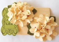 How cute are these???  Hydrangea hair clips!  This site has the cutest hair bands and clips I've seen!