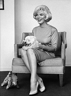"""At the Beverly Hills Hotel.  1961  ©1978 Eric Skipsey  Maf was a little white French poodle who was given to MM in New York by Frank Sinatra. Sinatra had purchased the dog from Natalie Wood's mother. As has been widely reported, Marilyn named the dog """"Maf"""" because of Frank Sinatra's alleged mafia connections."""
