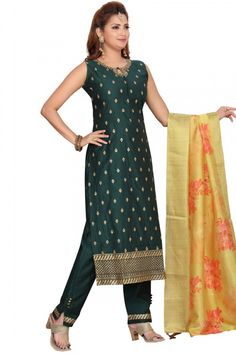This dark green chanderi silk trouser suit will make you absolutely astoundingly gorgeous. This key hole neck and sleeveless attire designed using stone work. Teamed up with chanderi silk cigarette pant in dark green color with yellow organza dupatta Cigarette pant has lace work. Dupatta highlighted with floral print work. #trousersuit #salwarkameez #malaysia #Indianwear #Indiandresses #andaazfashion Trouser Suits, Trousers, Différents Styles, Pantalon Cigarette, Stone Work, Uk Fashion, Jacket Style, Silk Fabric, Indian Dresses