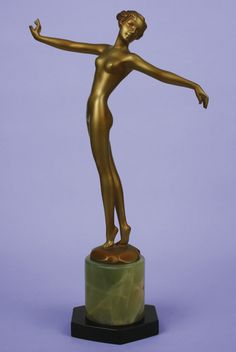 """An Art Deco Austrian bronze figure by Josef LORENZL, circa 1930 depicting a stylish posing nude, w/ a gold and enamelled cold-painted finish, mounted on a green onyx and black marble base. H. 32cm /12.75"""". Bronze base stamped Lorenzl. (hva)"""