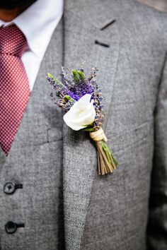 Lavender & White buttonhole - Image by Cassandra Lane Photography - A Charlie Brear lace and silk dress for a west midlands vintage DIY barn wedding with a blue colour scheme and photography by Cassandra Lane