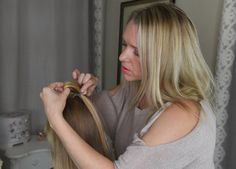 Beth begins by tying the front section of hair in a bobble