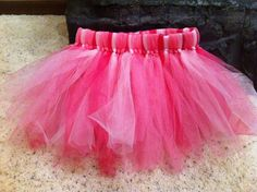 how to make a tulle skirt - I like how she tied knots on the ends to secure the tulle to the elastic.