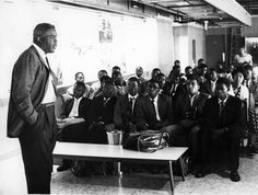 Jackie Robinson addressing students from Kenya and East Africa that were brought to the United States to study by the African American Students Foundation. Robinson, who headed the fundraising campaign for the 1959 airlift, was a baseball star, civil rights activist and the first African-American Major League Baseball player. Most likely this photo is from 1960.    Photo courtesy of Cora Weiss via collective-history