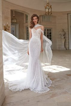Wedding Dresses Casual This soft mermaid gown artfully draped with a delicate silk tulle and embroidered with scattered pearls and shimmery sequins features a sweetheart neckline, flowing skirt, and a sheer cape that attaches to the sweetheart neckline. White Bridal Dresses, Country Wedding Dresses, Best Wedding Dresses, Bridal Gowns, Wedding Gowns, Tulle Wedding, Mermaid Wedding, Sheer Wedding Dress, Elegant Wedding