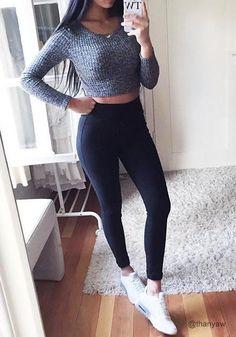 Full view of thanyaw in black classic high-waist leggings