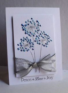 Beautiful silver embossed flowers with blue liquid pearls.
