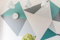 Have you ever fancied a feature wall in a room in your home but not keen on one block of colour or wallpaper? Then why not design your own geometric design with tester paints you have lying around the house! That's what Cath did to create this wonderful wall in her kitchen and she's here to tell you all about it… #wallmural #geometrics #triangles #featurewall