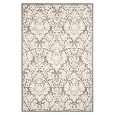 Add a pop of pattern to your living room or den with this artfully loomed rug, showcasing a floral motif in dark grey and beige.  Pr...