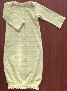 A tutorial for the Stitched-Together Baby Gown with the Shell Tuck Edge trim.