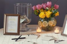 Pink and yello tulip, rose, and lemon centerpiece by Liliana Sierra/Don Mears Photography