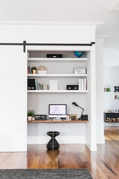 Now you see it, now you don't. Clever use of sliding door to close off this perfect home office space.