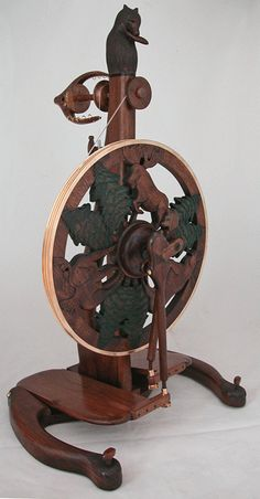 Beautiful spinning wheels. I have one of his drop spindles, maybe someday I can order one of his wheels with sea creatures carved in it.