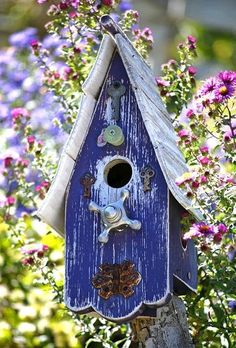 blue bird house out of recycled materials.
