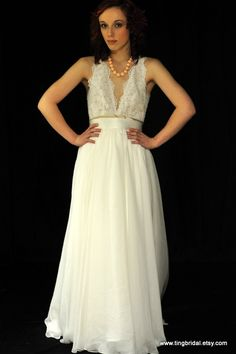 BarbaraCity Country Beach BrideCustom Aline V neck by TingBridal, $950.00 -- I would have to eliminate the golden touches in the sash.