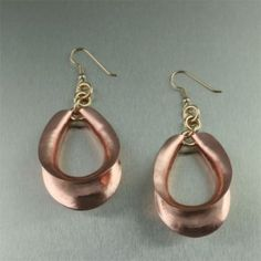 Anticlastic Copper Earrings - Geometric excellence is showcased in this pair of stunning earrings. Anticlastically raised and handcrafted in copper, these earrings are accented by 14K Gold Filled earwires.