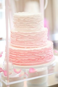 Pink ruffled cake by Kendall's Cakes.