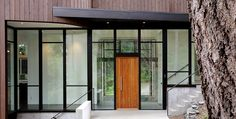 Many front door ideas combine different materials. If you have a large garden with a high fence, you can opt for a modern front door made of glass and Contemporary Front Doors, Modern Entrance, Modern Entry, Modern Front Door, House Front Door, Entrance Design, House Entrance, Front Entry, Entry Doors