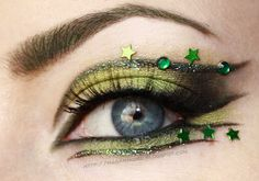 St. Patrick's Day inspired eye make-up with green stars and crystals by Madam Noire.