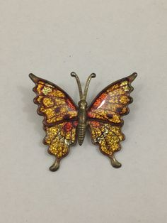 Vintage metal butterfly brooch with orange by TheTravelingTortoise