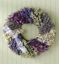 Designed in a patchwork fashion, this handmade wreath of dried larkspur, phalaris and English lavender is accented with white sinuata, green eucalyptus and a sheer lavender bow. Gorgeous color and texture for anywhere indoors. Lavender Crafts, Lavender Wreath, Lavender Bouquet, Deco Floral, Arte Floral, Wreath Crafts, Diy Wreath, Corona Floral, Indoor Wreath