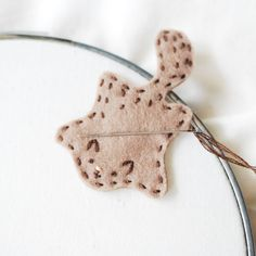 flying squirrel needle minder, magnets keep your needle in place // wild olive