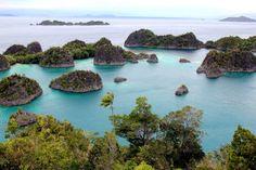 Painemo Island, Blue Lagoon, Raja Ampat, West Papua, Indonesia photo by Shunga_Shanga on Envato Elements Great Places, Places To Go, Beautiful Places, Amazing Places, Raja Ampat Islands, West Papua, Relaxing Holidays, Airlie Beach, Australia Travel