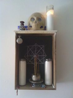babalon156:    This is out small living room altar - the back of the altar is painted with chalkboard paint… easy to sigil or whatever.