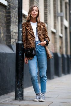 25 Ways to Make Mom Jeans Look Modern - a leopard print blazer + white t-shirt and scuffed Chuck Taylor's make these mom jeans look chic | StyleCaster