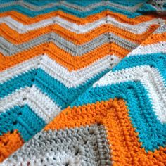 Chevron pattern crocheted blanket. These colors are great. Must make.