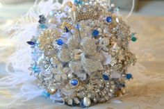 I'm not a flower fan at all, but I have a bunch of vintage brooches from my great-grandma...so a brooch bouquet is a perfect idea for my something old and something blue.