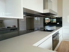 Enhance your space with the sophisticated look of a mirror splashback!