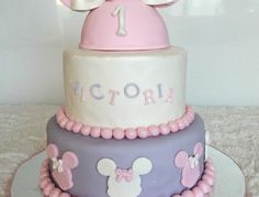 """My VERY FIRST two-tier cake ever! Baby Minnie Mouse themed for Victoria's first birthday. Top tier is a vanilla with a pink zebra pattern inside. Bottom is pink velvet. Handmade Minnie """"hat"""" using fondant formed around a styro ball. My favorite part is definitely the bow!  Sharon A. *** Not Your Average Cupcake! https://www.facebook.com/Notyouraveragecupcake"""