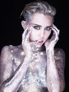 Rankin - Miley's elf ears and piercing eyes are so high fashion. She wears the glitter, it doesn't wear her.