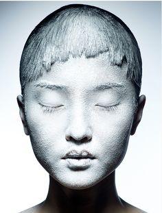 #skin #paint-on-skin #paint #art #colors #photography #abstract #face #black #white #paste    Du Juan. Vogue China, April 2010. Photo: Raymond Meier.