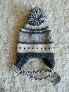 Earflap knit gray/smokey hat with pompom acrylic and polyamide yarn on Etsy, $19.70 AUD