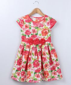 Crafted with cool, cozy cotton, a gathered skirt and blossoming flowers, this dress is full of warm stylish flair that mixes perfectly with any weather.