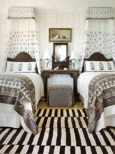I am dreaming of these cozy and breezy guest room quarters for a beach home! If only I could identify the designer!