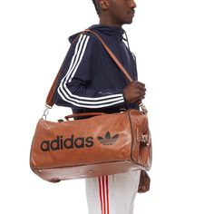 SP Archive bag from the S/S2017 Adidas Originals collection in brown This bag is from adidas Originals new collection. The bag, here in brown, is made of polyurethane and features a zip closure, wide inner compartment, adjustable shoulder strap, handles, buckles and adidas logo. - Bag - Zip closure  - Handles and buckles - Inner compartment - Adjustable shoulder strap - adidas logo - Composition: 100% Polyurethane  - Code: BK4218