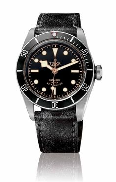 """The Tudor Heritage Black Bay """"Black"""" on a distressed """"aged"""" black leather strap. Read more at: http://www.watchtime.com/wristwatch-industry-news/watches/a-darker-diver-introducing-the-tudor-heritage-black-bay-black/ #tudorwatches #watchtime #divewatch"""