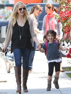 Having a blast: Sarah Michelle Gellar shares a laugh with her daughter Charlotte Prinze as they leave school in Santa Monica