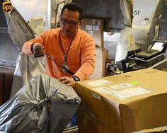 UPS worker sorting parcels