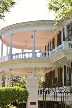 Charming double southern porch......I love this one and I want to sit for a while in the upper porch. B.