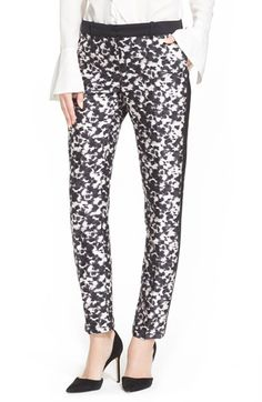 "Free shipping and returns on Rachel Zoe 'Ange' Print Tuxedo Stripe Cigarette Pants at Nordstrom.com. <p><B STYLE=""COLOR:#990000"">Pre-order this style today! Add to Shopping Bag to view approximate ship date. You'll be charged only when your item ships.</b></p><br>A mottled monochrome print puts a playful spin on a pair of ultrachic cigarette pants accented with classic tuxedo stripes streaking down the outseams."