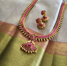 Silver gray kanchipuram silk saree with dusty rose and pale green gold border paired with temple haram necklace and jhumkas