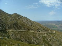 The Swartberg mountains (black mountain in Afrikaans) make up a mountain range that runs roughly east-west along the northern edge of the semi-arid Little Karoo in the Western Cape province of South Africa