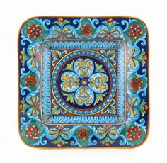 This splendid wall plate has been painted by Eugenio Ricciarelli, another Deruta, Italy ceramic artist who spent time in Franco Mari's studio before opening his own place.