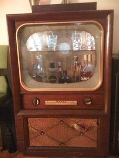 Vintage TV gone dry bar! What a cute idea!
