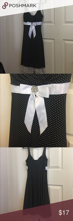 Black and white polka dot dress, size small Cute polka dotted dress, has tool on the bottom. only worn once. Dresses
