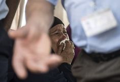 Cairo, Egypt. A relative of a passenger who was flying aboard an EgyptAir plane that vanished from radar en route from Paris to Cairo overnight cries as family members are transported by bus to a gathering point at Cairo airport. Debris from the missing plane was found floating in the Mediterranean but investigators appeared no closer to explaining why flight MS804 suddenly plunged into the sea killing all 66 on board.